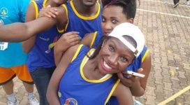 Re!gnite Africa's Sarah Owembabazi (at the far back) gets a selfie moment with friends after the 2016 cancer run.