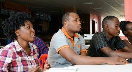 Mugisha (middle) in a Re!gnite Africa seminar with fellow trainees